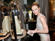 Kate Bosworth attended the Van Cleef & Arpels boutique opening carrying an elegant pearlized box clutch by Edie Parker.