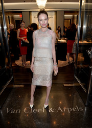 Kate Bosworth went contemporary-chic in a sheer silver blouse with a bandeau underlay, both by Monique Lhuillier, at the Van Cleef & Arpels boutique opening.