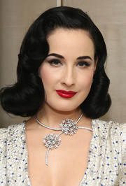 Dita Von Teese accessorized with an intricate floral diamond necklace for a totally glamorous look.