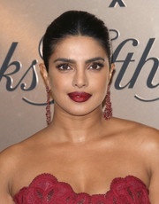 Priyanka Chopra-Jonas matched her dress with a pair of ruby chandelier earrings by Lorraine Schwartz.