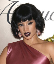 Dascha Polanco went for a vampy beauty look with a swipe of dark purple lipstick.