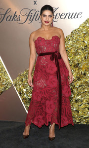 Priyanka Chopra-Jonas looked fetching in a strapless red gown by Oscar de la Renta at the Vanity Fair 2019 Best Dressed List event.