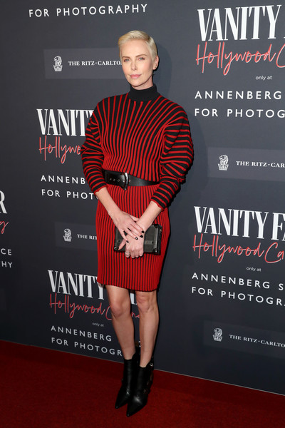 Charlize Theron was edgy-chic in a red and black striped turtleneck dress by Louis Vuitton at the Vanity Fair: Hollywood Calling event.