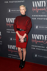 Charlize Theron teamed her frock with black ankle boots, also by Louis Vuitton.