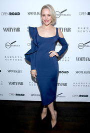 Rachel McAdams cut a shapely figure in this blue cold-shoulder ruffle dress by David Koma during the 'Spotlight' private dinner.