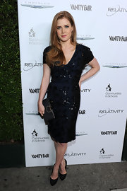 Amy Adams gave her look a glamorous finish with a black satin Musetta Gancini clutch.