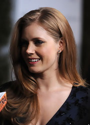 Amy Adams paired her navy dress with Croco hoop earrings with diamonds.