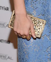 A gold shimmery clutch gave Jessica Lowndes a hint of glamour at the Vanity Fair Campaign Hollywood event.