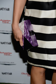 Abigail Spencer added a splash of color to her black and white look with an iridescent purple clutch.
