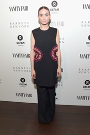 Rooney Mara attended the Vanity Fair Campaign Hollywood dinner wearing a black cutout tunic by Celine.