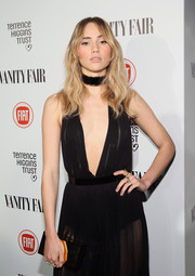 Suki Waterhouse paired a mirrored box clutch with a very sultry gown for the Fiat Young Hollywood celebration.