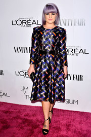 Kelly Osbourne kept it modest in a long-sleeve print dress during the Vanity Fair Campaign Hollywood kickoff.