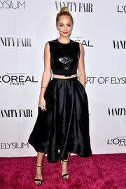 Laura Vandervoort contrasted her edgy top with an ultra-feminine black satin skirt.