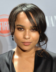 Zoe Kravitz attended the Young Hollywood celebration wearing a romantic side chignon.