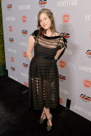 Sasha Spielberg paired her dress with edgy-glam Janis T-strap pumps by Saint Laurent.