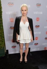 Taryn Manning layered a black tux jacket over a strapless white peplum top and shorts combo for the Young Hollywood celebration.