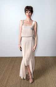 Paz Vega donned a pleated nude Chanel dress with a slouchy bodice and a high-low hem for the Vanity Fair and Chanel dinner at Cannes.
