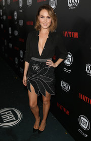 Camilla Luddington looked seductive at the Vanity Fair and Fiat Young Hollywood celebration wearing this unbuttoned black shirt.