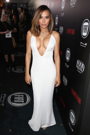 Naya Rivera put her assets on display in a body-con white Tadashi Shoji gown with a dangerously low neckline during the Vanity Fair and Fiat Young Hollywood celebration.