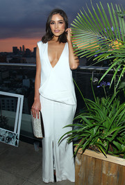 Olivia Culpo took a daring plunge in a deep-V white maxi dress during the Vanity Fair and Guess Summer Soiree.