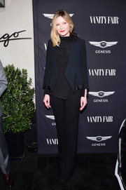 Kirsten Dunst layered a navy blazer over a black high-neck blouse for Vanity Fair's celebration of 'Hidden Figures.'