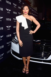 Taraji P. Henson went the ladylike route in a black one-shoulder dress with white ruffle detailing when she attended Vanity Fair's celebration of 'Hidden Figures.'