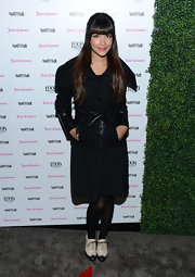 Hannah Simone opted for a classic wool coat with a funky edge with this coat with leather sleeves and belt.