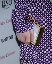 Ellie Kemper's clutch acted as a carryall and a mirror at the 2013 Vanities Calendar event.