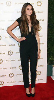 Shailene Woodley wore this deep-plunging black jumpsuit for the Vanity Fair anniversary party.