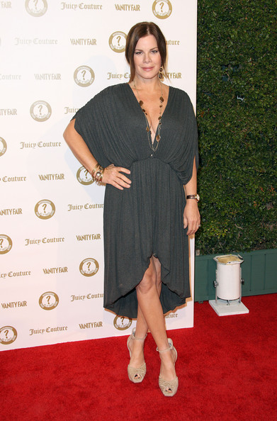 Marcia Gay Harden combined a draped dress with skintone peep-toes at the Vanity Fair and Juicy Couture party.