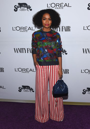 Yara Shahidi rounded out her vibrant look with a blue Chanel backpack.
