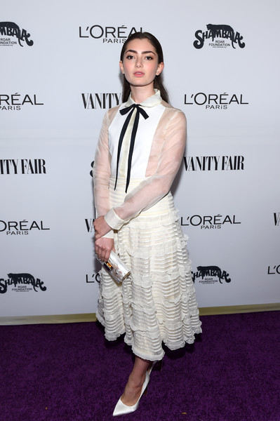 Emily Robinson opted for an ivory RED Valentino shirtdress, featuring a ruffle skirt and black bow detailing, when she attended the Toast to Young Hollywood event.