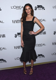 Nicole Trunfio paired her cute frock with black ankle-strap sandals.