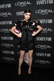 Sofia Carson went for whimsical glamour in a Marc Jacobs LBD with a pink lining and oversized ruffle detailing at the Vanity Fair New Hollywood celebration.