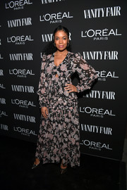Susan Kelechi Watson chose a floral maxi dress by Thurley with small cutouts along the waistline for the Vanity Fair New Hollywood celebration.