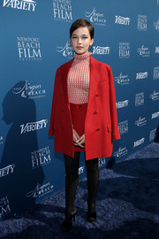 Cailee Spaeny worked a retro vibe with this red Valentino skirt suit and turtleneck combo at the Newport Beach Film Festival Fall Honors.