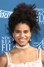 Zazie Beetz wore her natural curls in a messy updo at the Newport Beach Film Festival Fall Honors.