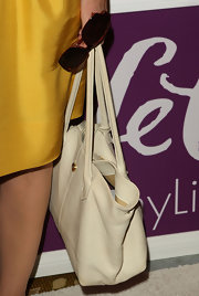 Jane Kaczmarek paired a simple white tote with her bright dress at the Power of Women luncheon.