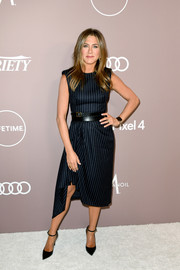 Jennifer Aniston opted for a pinstriped midi dress by  Alexander McQueen when she attended the 2019 Variety Power of Women: Los Angeles.