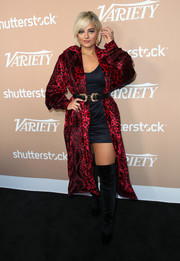 Bebe Rexha looked sultry in a red leopard-print coat layered over a black mini dress at the Hitmakers Brunch.