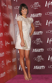 Lea Michele paired her white organza frock with a classic beige clutch.