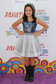 Bailee Madison stepped out at the Power of Youth event wearing a pair of mid-calf boots.