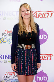 Bridgit Mendler covered up in a charming navy cardigan that sported stripe cutouts.