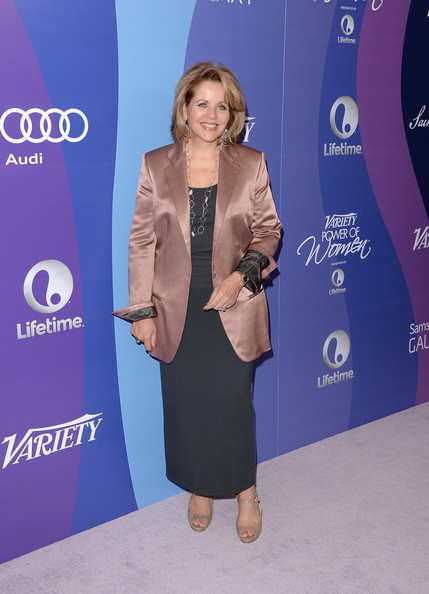 Renee Fleming layered a mauve silk blazer over a black evening dress for the Variety Power of Women event.