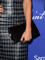 Jessica Alba kept it simple yet elegant with this black leather clutch by Christian Dior at the Variety Power of Women event.