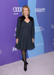 Abbe Raven attended the Variety Power of Women event wearing a blue cocktail dress with black leather inserts on the shoulders.