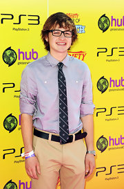 Angus T. Jones attended the Power of Youth event wearing a gray button-down, a patterned tie, and khakis.