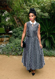 Janelle Monae styled her look with studded black T-strap pumps by Christian Louboutin.