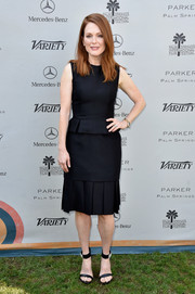 Julianne Moore teamed her dress with edgy-elegant Alexander McQueen sandals featuring embellished ankle straps.