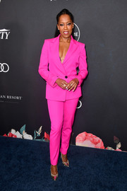 Regina King styled her suit with a pair of gold pumps by Nicholas Kirkwood.